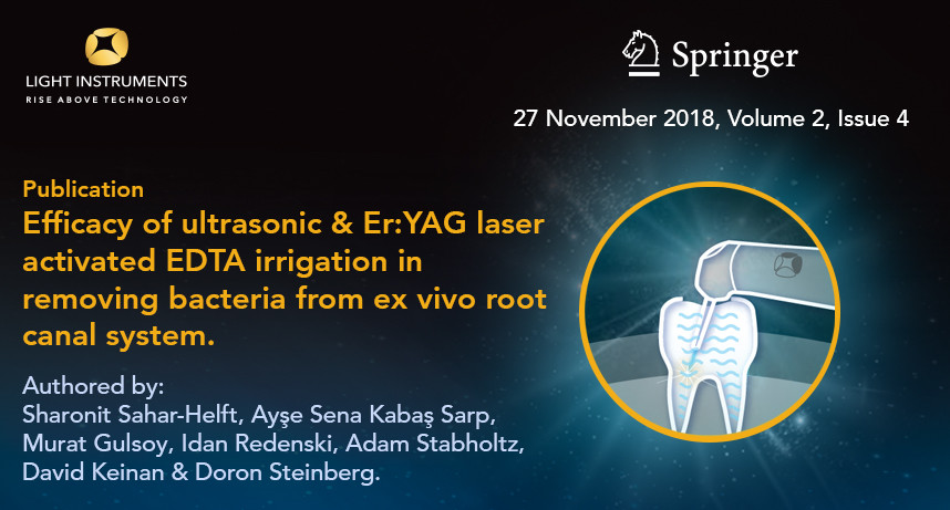 Efficacy of ultrasonic and Er:YAG laser activated EDTA irrigation in removing bacteria from ex vivo root canal system